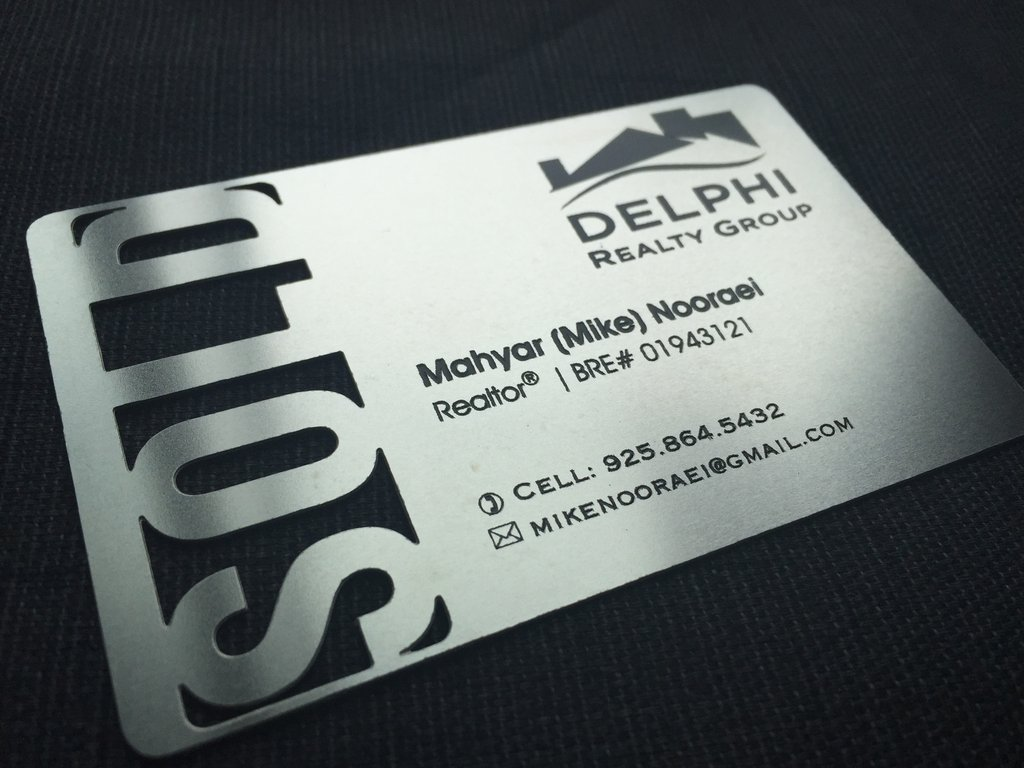 Business card with sold sign